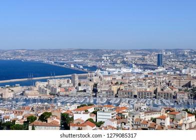 France, Provence-Alpes-Cote d'Azur, Bouches-du-Rhone, Marseille. The view of Marseille and the old harbor from the Basilique Notre Dame de la Garde