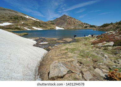 France Pyrenees mountain Casteilla lake with fishermen, landscape in the natural park of the Catalan Pyrenees