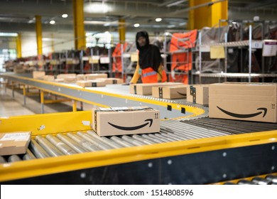 Vélizy, FRANCE Sept. 23th 2019 :  Logistics activity on the Amazon site of Vélizy-Villacoublay in France. Packages are sorted by workers on coneyors.