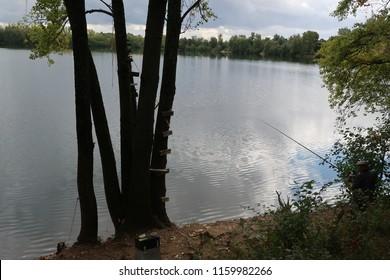 Varennes-lès-Mâcon, France – September 15, 2017: photography showing the lake of Varennes-lès-Mâcon and a fisherman (on the right).