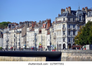 Besançon, France - September 9, 2018:  The Pont Battant over the Doubs River and facades of old buildings on Quai Veil Picard.