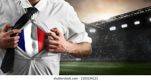 France soccer or football supporter showing flag under his business shirt on stadium.