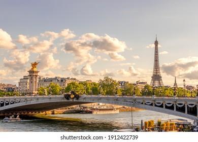 France. Sunny summer day in Paris. Alexander III Bridge and Eiffel Tower