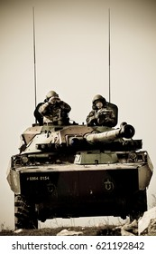 France, the training center of the foreign legion - circa, 2011. Legionnaires of the 1st Cavalry Regiment of French Foreign Legion on AMX-10 tank during exercises.