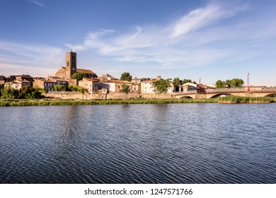 France, Trebes, near Carcassonne: Panorama skyline view of French small town with Aude river, Church Saint Etienne, cityscape, skyline bridge and blue sky in the background - concept travel history