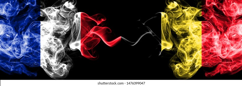 France vs Belgium, Belgian smoky mystic flags placed side by side. Thick colored silky abstract smokes banner of French and Belgium, Belgian