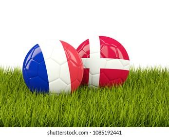 France vs Denmark. Soccer concept. Footballs with flags on green grass. 3D illustration
