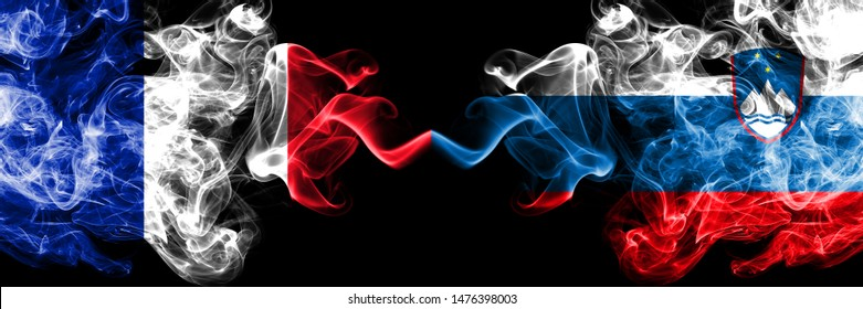 France vs Slovenia, Slovenian smoky mystic flags placed side by side. Thick colored silky abstract smokes banner of French and Slovenia, Slovenian