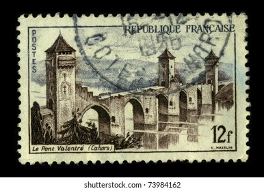 FRANCE-CIRCA 1956:A stamp printed in France shows image of the The Pont Valentre  is a fourteenth century six-span fortified stone arch bridge crossing the Lot River to the west of Cahors,circa 1956.