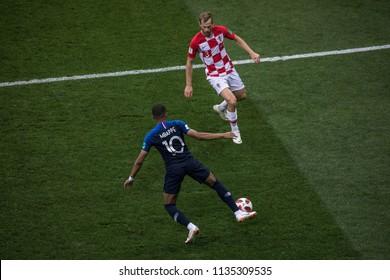 "France's Kylian Mbappe with a ball agains Croatia's Ivan Strinic at World Cup 2018 final match France vs Croatia. ""Luzhniki"" Stadium, 15th July 2018."