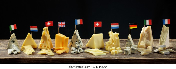 Franch, Italian, English, Holland, German  and Swiss cheeses maasdam, appenzeller, cheddar, gorgonzola and roquefort wedges
