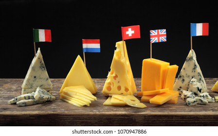 Franch, Italian, English and Swiss cheeses maasdam, appenzeller, cheddar and roquefort wedges