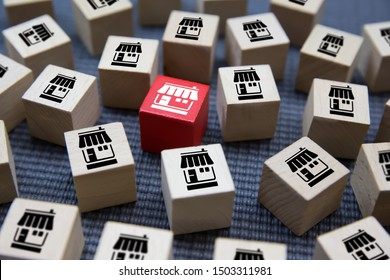 Franchise business on Cubes wood concept or wooden blog with franchise marketing store icons for Business Growth,Credit approval for business expansion.