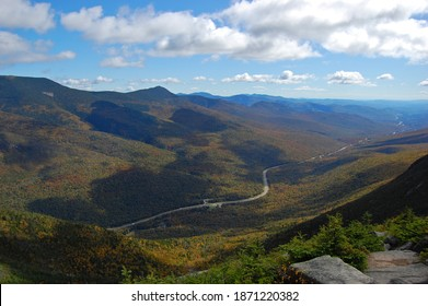 Franconia Notch with fall foliage and Highway I-93 aerial view from top of the Cannon Mountain in Franconia Notch State Park in White Mountain National Forest, near Lincoln, New Hampshire NH, USA.