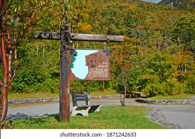 Franconia Notch with fall foliage and Old Man of the Mountain sign in Franconia Notch State Park in White Mountain National Forest, near Lincoln, New Hampshire NH, USA.