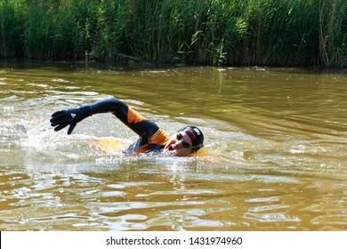 FRANEKER / THE NETHERLANDS - June 23 2019: Maarten van der Weijden during his passing through in Franeker swims 200 kilometers in Friesland to raise money for research into the cure of cancer
