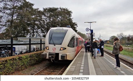 Franeker / Netherlands - October 14 2017: A Stadler GTW Diesel Train of Arriva at the small station of Franeker in Friesland. The destination of the passenger train is Harlingen Haven