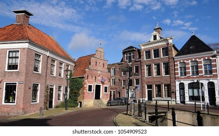 Franeker / Netherlands - October 14 2017: Old Medieval and Renaissance buildings on a summer day in the small idyllic town Franeker in Friesland