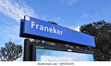 Franeker / Netherlands - October 14 2017: The station name sign / board of the dutch village Franeker in Friesland.