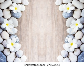 frangipani flower and stone zen spa on wood