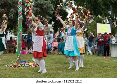 Frankenmuth, Michigan, USA - June 10, 2018 Members from the Frankenmuth dance center perform the maypole dance during the Bavarian Festival.