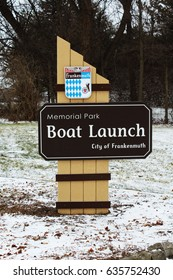 Frankenmuth, MI/USA:  Jan 29, 2017 – Boat launch sign on the Cass River at Memorial Park in the city of Frankenmuth Michigan