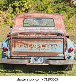 """FRANKENMUTH, MI/USA - SEPTEMBER 9, 2017: A 1948 Chevrolet pickup truck at the Frankenmuth Auto Fest held in Heritage Park, stating """"Body & paint by mother nature & father time!"""""""