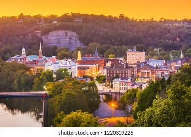 Frankfort, Kentucky, USA town skyline on the Kentucky River at dusk.