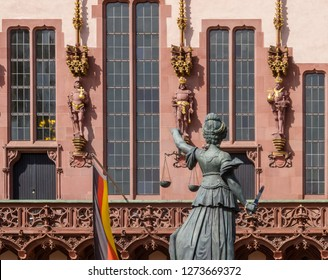 """Frankfurt a. M., Hessen, Germany - April 9 2010: Justitia, the sculpture of the """"Gerechtigkeitsbrunnen"""" (engl. Justice Fountain) in front of the """"Römer"""", the historical town hall."""