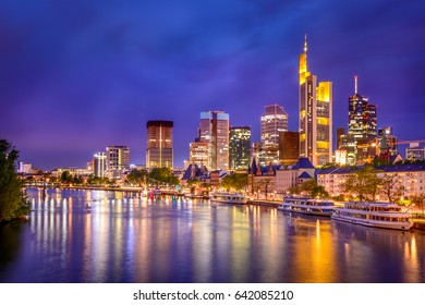 Frankfurt city skyline at night with scenic skyscrapers and view from the main river