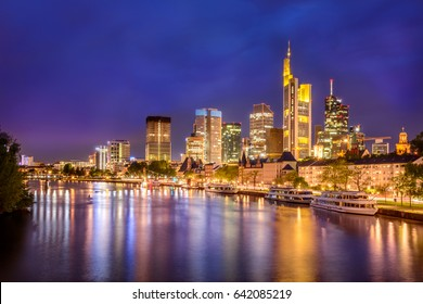 Frankfurt city skyline and skyscrapers at night and view from the main river