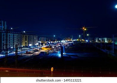 Frankfurt construction site of Europaallee at night with railroad tracks and trains photographed on 04.25.2015