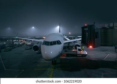 Frankfurt, DE - NOV 4, 2015: Lufthansa Airbus A320 at Frankfurt terminal at night