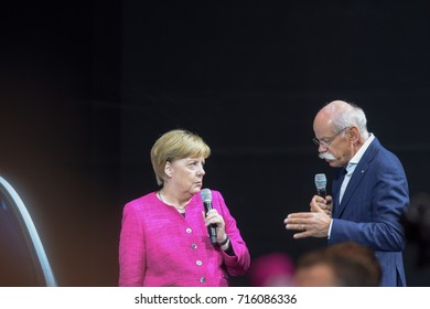 Frankfurt, Germany. 14th Sep, 2017. Angela Merkel visiting the Daimler / Mercedes-Benz booth during her tour through the 67th IAA International Motor Show in Frankfurt/Main on Tuesday, September 14th