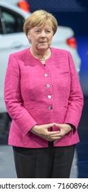 Frankfurt, Germany. 14th Sep, 2017. Angela Merkel taking a tour of the IAA. BMW booth. At the 67th IAA International Motor Show in Frankfurt/Main on Tuesday, September 14th, 2017