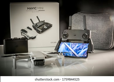 Frankfurt, Germany - 20th June 2020: A German photographer unboxed his new DJI Mavic Mini drone in the Fly More Combo and displayed it to take pictures for his website.