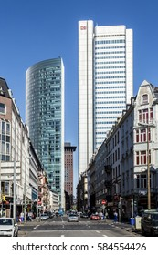 FRANKFURT, GERMANY - APR 15, 2015: view on office skyscraper building in Frankfurt, Germany at Taunusstrasse with people on street.
