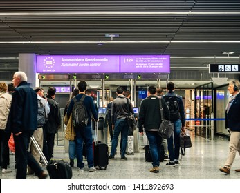 Frankfurt, Germany - Apr 29, 2019: Passengers people waiting in queue in Frankfurt INternational airport at Automated Border Control - EU BorderXpress Europe Kiosks‎