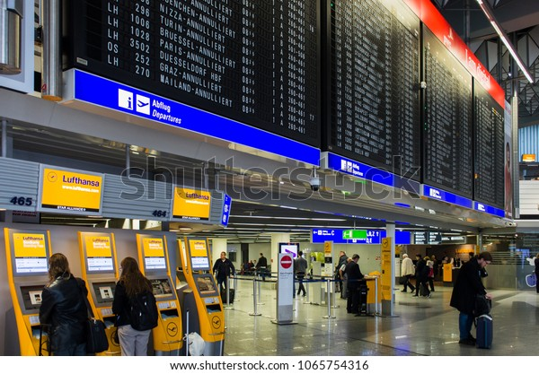 Frankfurt, Germany - April 10 2018 : Flight information board showing flights delayed or cancelled due to industrial strike in Frankfurt airport, Germany