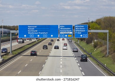FRANKFURT, GERMANY - APRIL, 18. The federal Autobahn A5 beneath the Airport of Frankfurt (Germany) in direction to the Frankfurt Kreuz with a road sign to the airport taken on April 18, 2015.