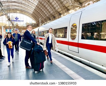 FRANKFURT, GERMANY - APRIL 25, 2019: View of Frankfurt Central Station, Hauptbahnhof from the train platform with people traveling visible.