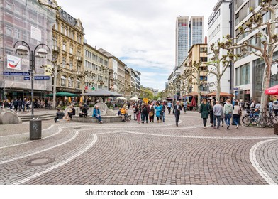 FRANKFURT, GERMANY - April 25, 2019: people walk along the Zeil in Midday in Frankfurt, Germany. Since the 19th century it is of the most famous and busiest shopping streets in German