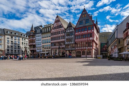 FRANKFURT, GERMANY - APRIL 25, 2019: People on Roemerberg square in Frankfurt, Germany. Frankfurt is the fifth-largest city in Germany.