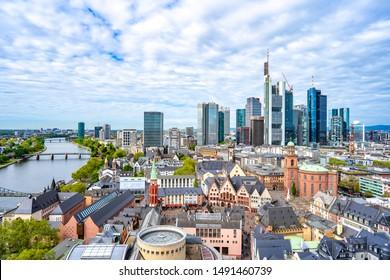 Frankfurt, Germany - April 25, 2019: Panorama Frankfurt am Main skyline , tourist boarding boat for siteseeing, Frankfurt, Germany