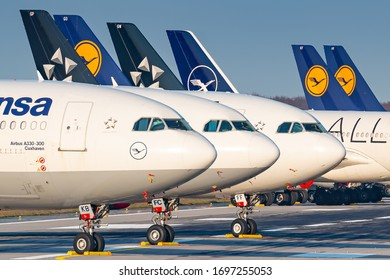 Frankfurt, Germany - April 7, 2020: Lufthansa Airbus A330 and A340 grounded and stored at Frankfurt airport (FRA) in the Germany. Airbus is an aircraft manufacturer from Toulouse, France.
