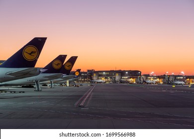 Frankfurt, Germany - April 7, 2020: Lufthansa airplanes grounded and stored at Frankfurt airport (FRA) in the Germany. Airbus is an aircraft manufacturer from Toulouse, France.