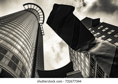 "Frankfurt, Germany - August 14, 2011: The ""Westend Tower"" (DZ Bank) in Frankfurt with its sculpture ""Inverted Collar and Tie"""
