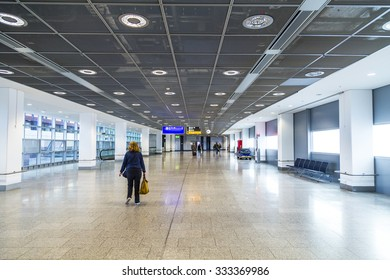 FRANKFURT, GERMANY- AUGUST 16, 2014: passengers at the departure hall. With 38 million passengers per year it is one of the most important airport in Europe.