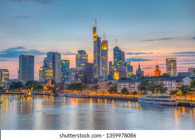 FRANKFURT, GERMANY, AUGUST 17, 2018: Sunset view of skyscrapers alongside river Main in Frankfurt, Germany