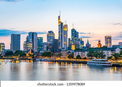 FRANKFURT, GERMANY, AUGUST 17, 2018: Sunset view of skyscrapers alongside river Main in Frankfurt, Germany